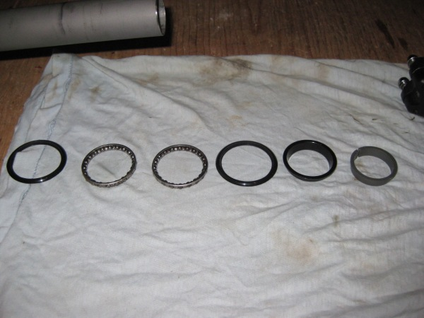 Close up of bearings and parts, cleaned.