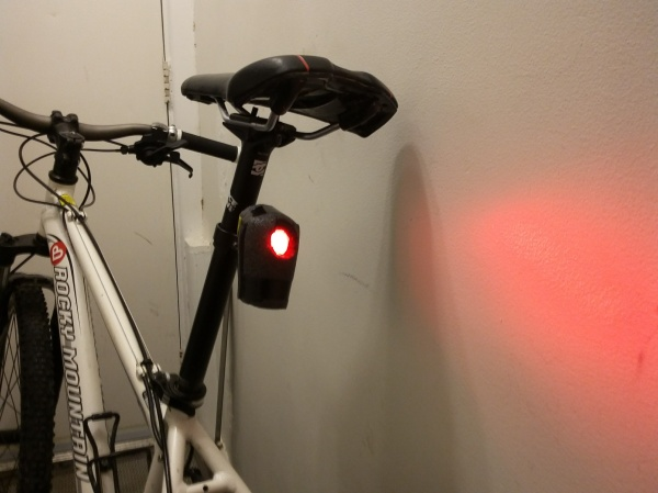 On the bike and lit up