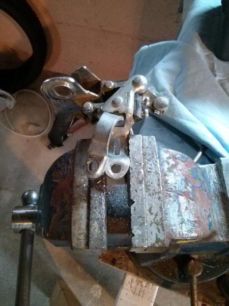 Derailleur bracket drilled oversize.